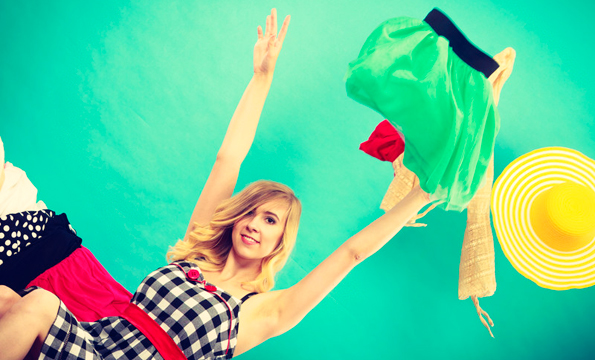 Girl Throwing Clothes in Air